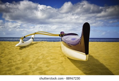 Purple Outrigger Canoe on Sandy Beach Overlooking Ocean and Horizon