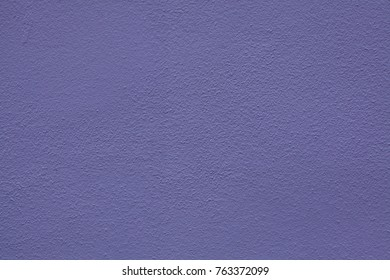 Purple painted stucco wall. Background texture.