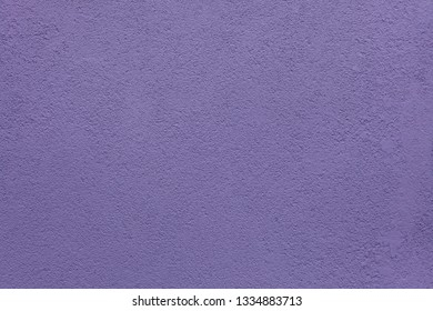 Purple painted stucco wall on Burano Island in the Venetian Lagoon near Venice, Italy. Background texture.