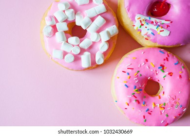 Purple and Pink Donuts On Pink Background