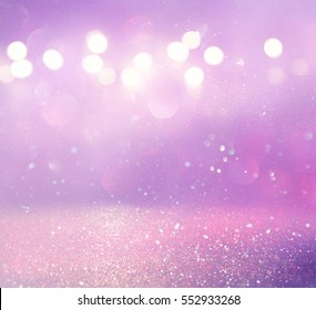 purple and pink glitter vintage lights background. defocused
