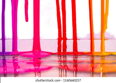 purple pink and red colors of screen print colors are dripping in white background