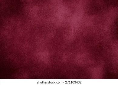 Purple red grunge wall background with dark spots