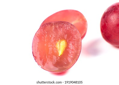 Purple ripe grapes cut in half on the white background. Close up photo. Ecological fruit for vegans. Vitamins.