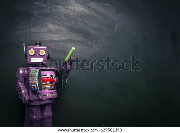 purple robot teacher and black board