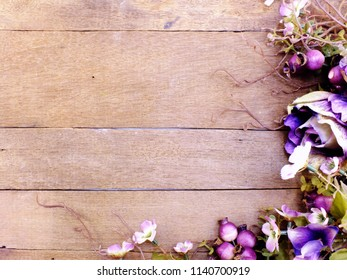purple roses artificial bouquet with space on wooden background with filter color
