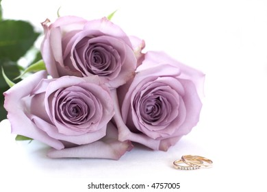 Purple roses and wedding rings