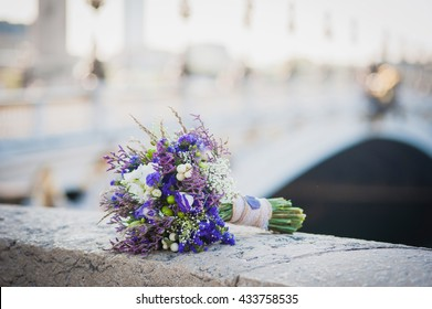 Purple rustic wedding bouquet. Lavender, wildflowers and berries.