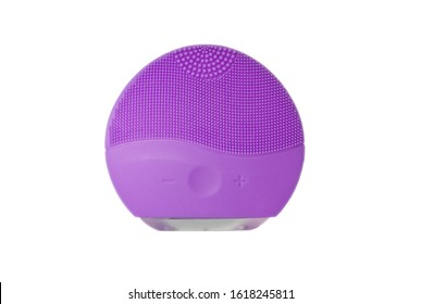 Purple silicone face cleansing brush isolated on white. Brushes for skin treatments. Cosmetic procedure. First step, skin cleaning. Peeling and gently rubbing face. Copy space, design space.