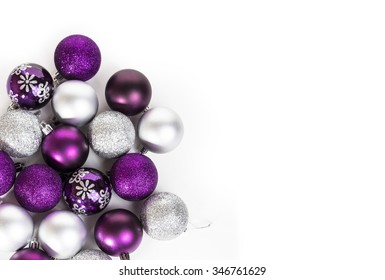 Purple and silver Christmas ballson a white table