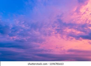 Purple sky amazing in the evening on twilight,Beautiful cloud with sunlight,Idyllic peaceful nature background,Dusk.