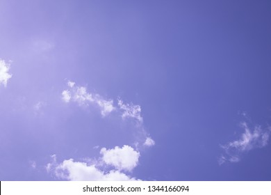 Purple sky background at sunset with clouds