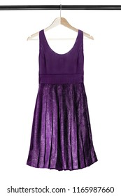 Purple sleeveless shiny dress hanging on wooden clothes rack isolated over white