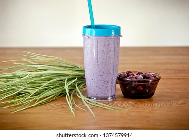 Purple Smoothie with Bowl of Blueberries on a Wood Table