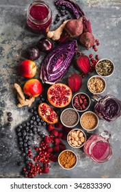 Purple smoothie bowl formula. Clean eating breakfast concept. Various purple and red veggies, fruit and superfoods and cereals ready to prepare smoothie bowl breakfast. Colorful food collage.