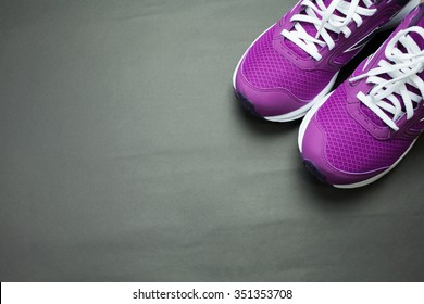 Purple Sneakers with black background
