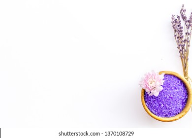 purple spa salt for aroma therapy with lavender flower fragrance on white background top view copyspace