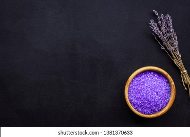 purple spa salt for aroma therapy with lavender flower fragrance on dark background top view copyspace