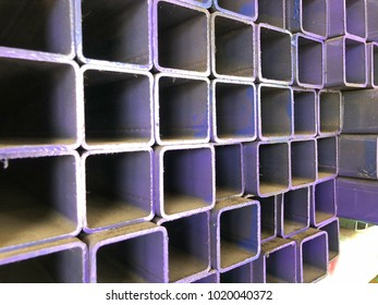 Purple square metal.Steel equipment.Industrial material.Purple square abstract texture.Square tube steel.