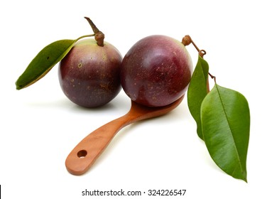 purple star apple fruit with leaf isolated on white background