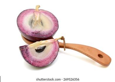 purple star apple fruit white background