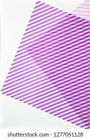 purple striped paper on illuminated white background