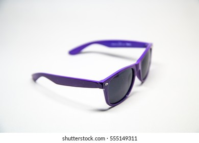 Purple sunglasses with black glass on white background