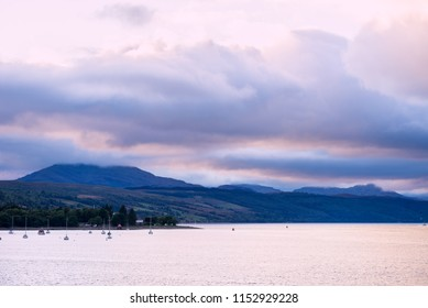 Purple Sunset at the Gare Loch or Gareloch (Gaelic: An Gearr Loch) is a sea loch in Argyll and Bute, Scotland, UK