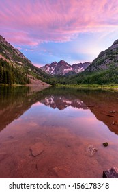 Purple Sunset at Maroon Bells - A spring purple sunset at Maroon Lake, with Maroon Bells towering at shore, Aspen, Colorado, USA.