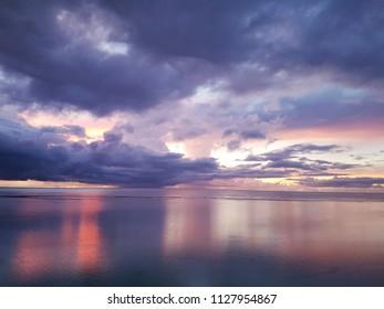 A purple sunset over a calm ocean.