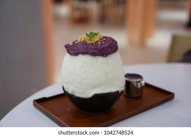 Purple Sweet Potato Kakigori, milk snow ice topped with mash purple sweet potato and crumble coconut, served with purple sweet potato sauce.