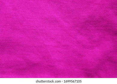 Purple texture background of empty seamless cotton colorful cloth wrinkled pattern. Simple blank backdrop of violet colour material to use as template, banner or wallpaper, close up top view