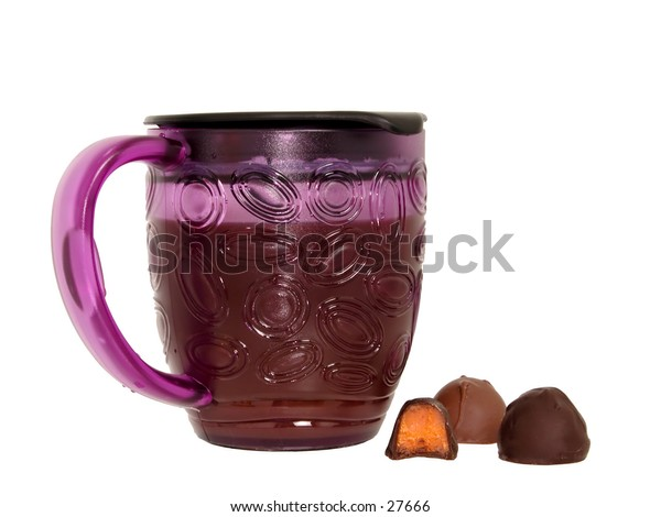 Purple thermos coffee mug with chocolate candy sitting on the side.  Isolated on white.