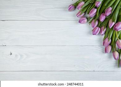 Purple tulips  on old used wood