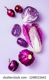 Purple vegetables on pastel color background. Minimal  concept. Plant based vegan or vegetarian cooking. Clean eating food, alkaline diet