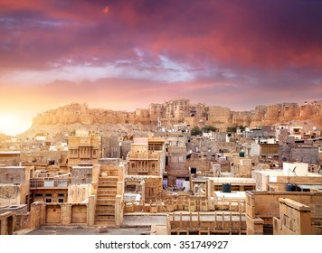 Purple vibrant sunset at indian desert city with Jaisalmer fort in Rajasthan, India