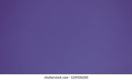 purple or violet background tone with night sky concept from Geminids one of the most spectacular meteor showers of the year and other small star with night sky