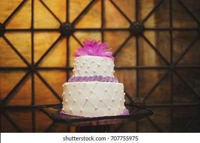 Purple & White Fancy Floral Circular Wedding Cake