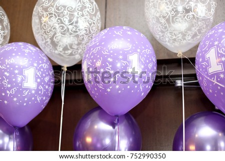Purple And White Helium Balloons Decorating A Wall For Babys First Birthday Party