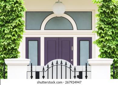 Purple wooden front door. London, UK