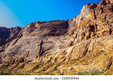 Purple, yellow, orange, magenta, vermilion and more emblazoned on the cliffs eroded by the Colorado River near Lees Ferry in Northern Arizona.