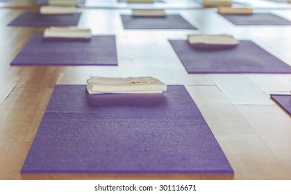 purple yoga mat on the floor