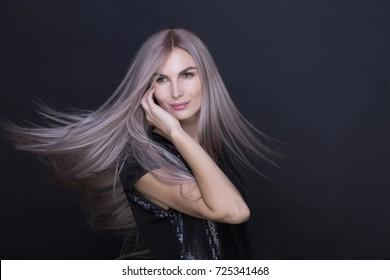 Purple-pink long straight hair. Nice woman smiling