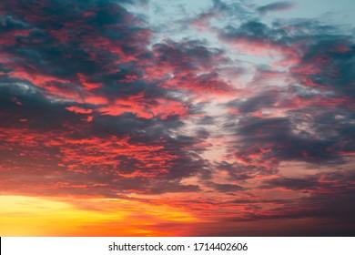 Purplish red, orange gradient sunset. Bright clouds wallpaper