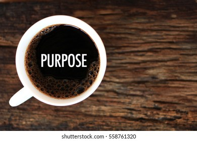 PURPOSE - business concept of coffee cup on wooden background