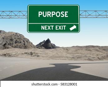 Purpose highway sign over road through desert