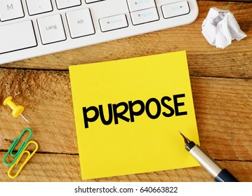 Purpose / Purpose sticker with marketing plan inscription over computer keyboard