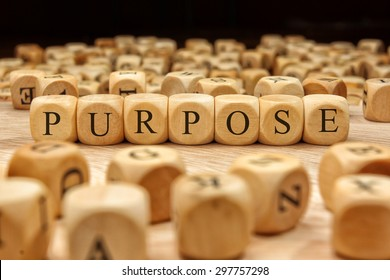 PURPOSE word written on wood block