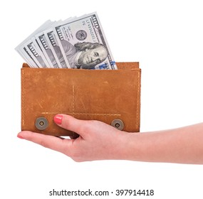 A purse of dollars in the woman hand isolated over white background