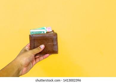 Purse money in dollars yellow background